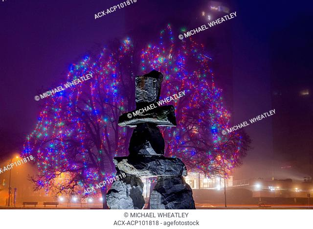 Inukshuk and Christmas lights at Elm Grove, English Bay, Vancouver, British Columbia, Canada