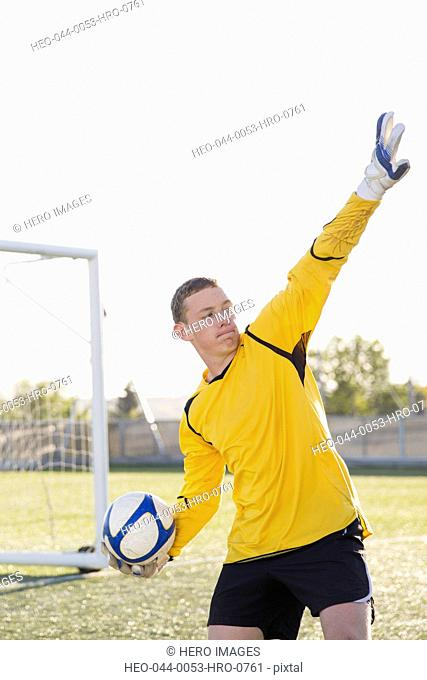 Soccer goalie ready to throw ball out