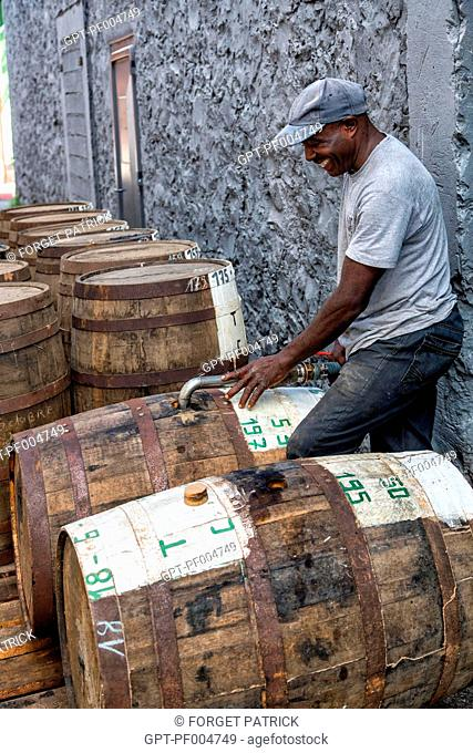 FILLING THE VATS WITH RUM, SAINT-JAMES DISTILLERY, SAINTE-MARIE, MARTINIQUE, FRENCH ANTILLES, FRANCE