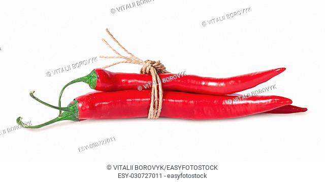 Red chili peppers tied with a rope isolated on white background