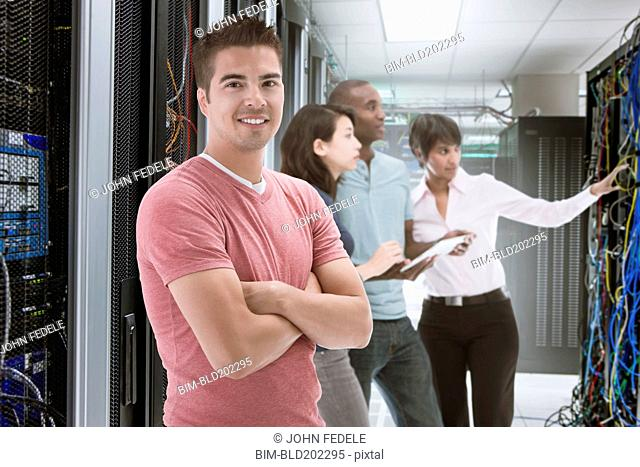 Business people standing in server room
