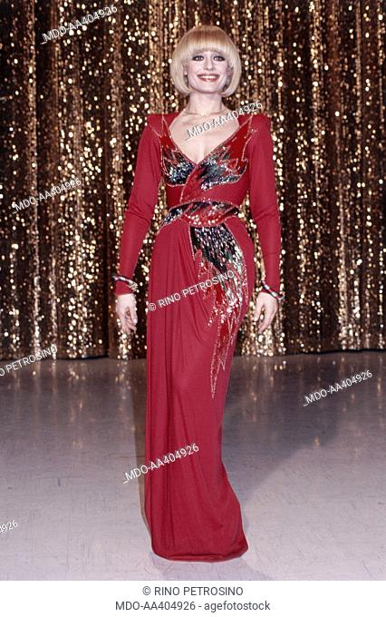 Raffaella Carrà wearing a red evening dress in Ma che sera. Italian TV presenter, actress, singer and showgirl Raffella Carrà (Raffaella Maria Roberta Pelloni)...