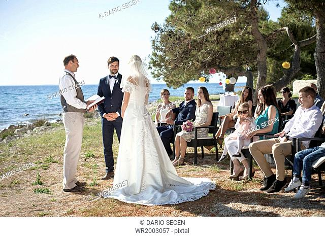 Bride and groom at wedding ceremony on beach