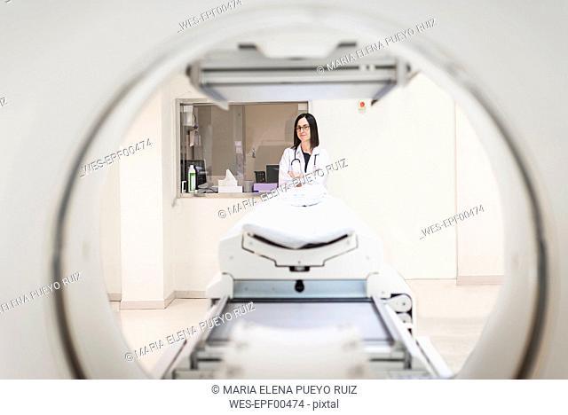 Doctor at MRI scanner