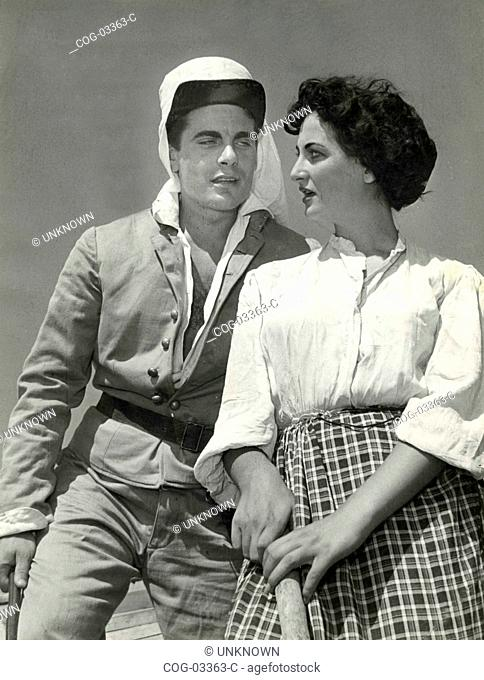 A couple of actors in costume in a scene from a movie, Italy