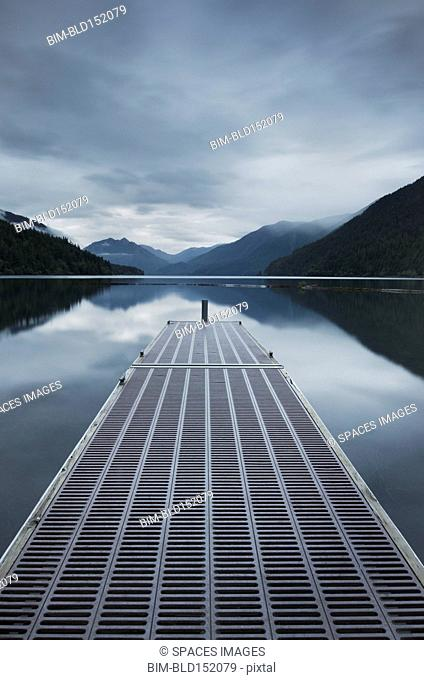 Metal pier over still remote lake