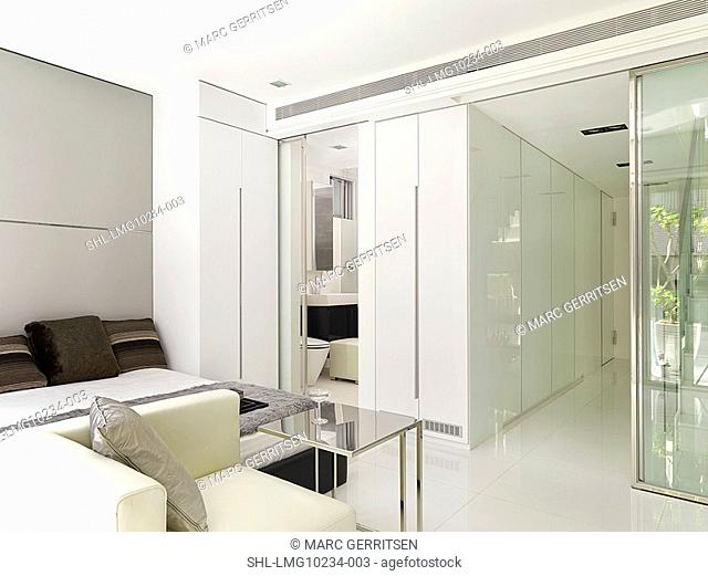 Mostly white modern bedroom and bathroom