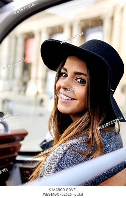 Portrait of smiling woman on a tour bus