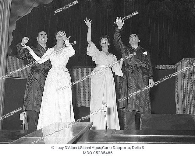 Italian showgirl Delia Scala (Odette Bedogni), Soviet actress Lucy D'Albert (Elena Lucy Johnson) and Italian actors Gianni Agus and Carlo Dapporto greeting at...