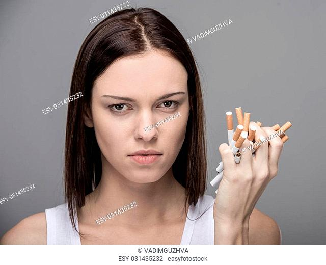 Young woman with many cigarettes.Concept of quit smoking