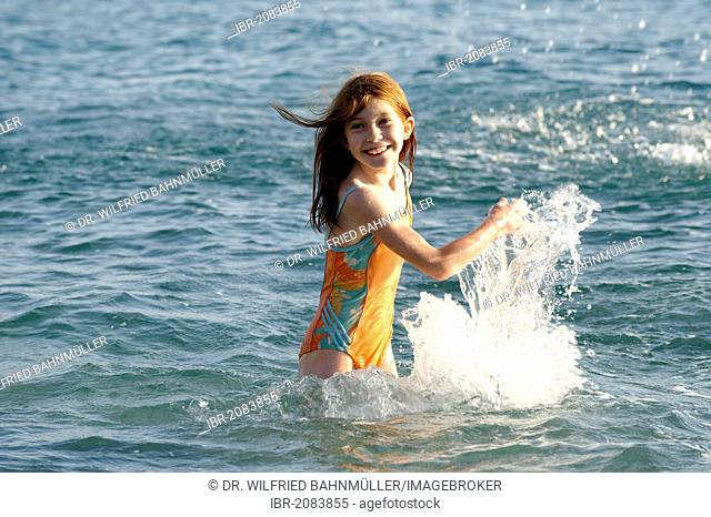 Girl splashing in the sea