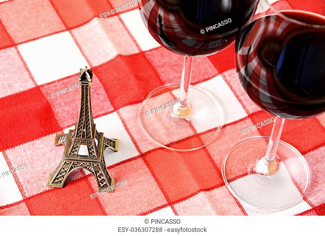 Souvenir Eiffel tower and a pair of wineglasses on the table