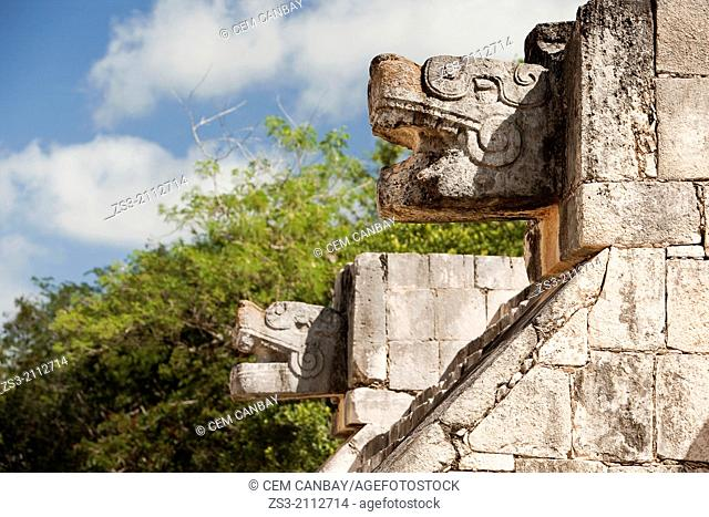 Temple with stone figures of the snake head symbolizes Kukulcan in prehispanic Mayan city of Chichen Itza Archaeological Site, Yucatan Province, Mexico