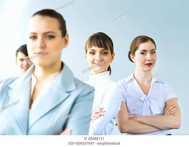successful businessmen, a portrait of a business woman standing next to colleagues