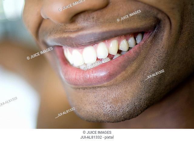 Extreme close up of African man's smile