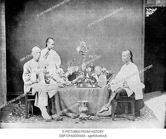 Smokers in a chinese opium den Stock Photos and Images | age fotostock