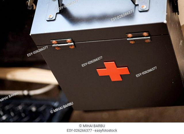 Color image of a metal first aid black box