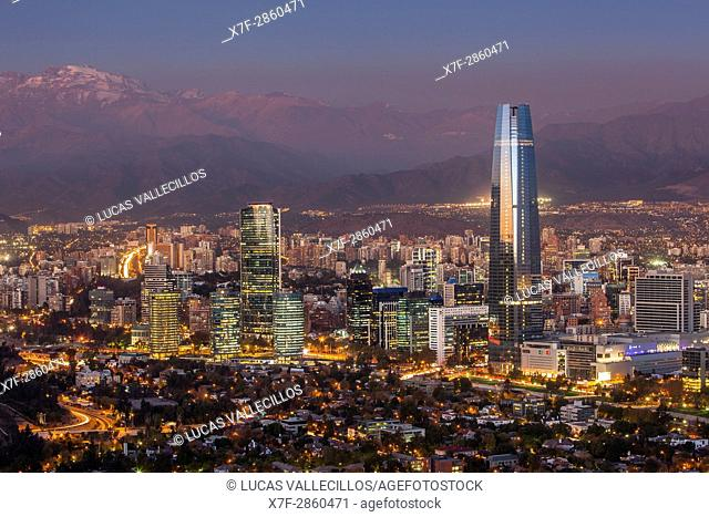 panorama of Santiago (Providencia buildings and the Gran Torre Santiago tower) and Andes Mountains, Santiago, Chile