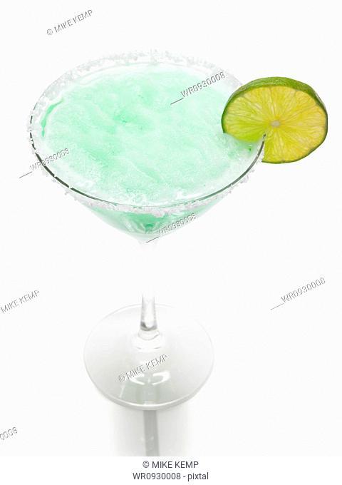 Frozen martini glass with lemon slice, studio shot