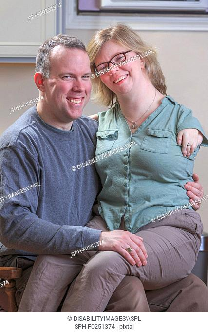 Woman with TAR Syndrome sitting on her husband's lap
