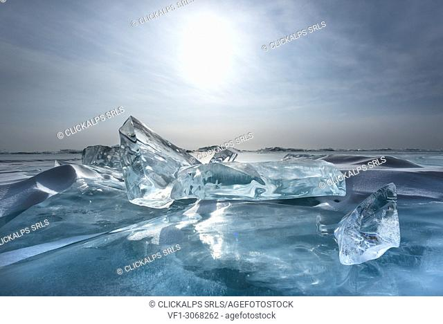 Pieces of transparent ice with sun reflection at lake Baikal, Irkutsk region, Siberia, Russia
