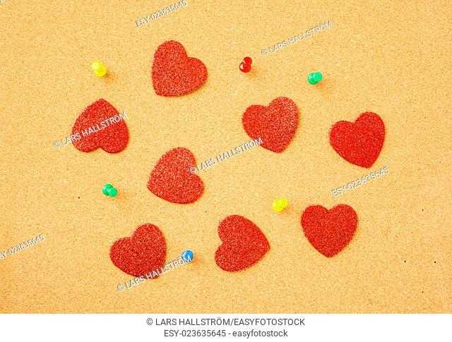 Hearts on noticeboard. Symbol of love, valentine holiday and office romance