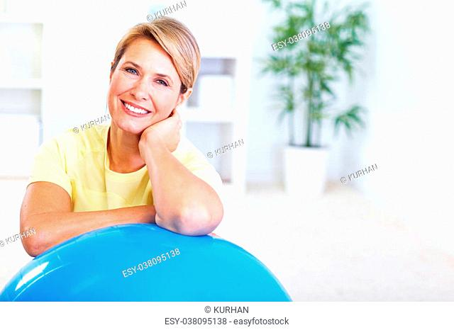 Senior woman doing yoga. Healthy lifestyle concept background
