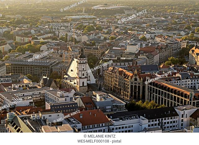 Germany, Saxony, Leipzig, City center with St. Thomas Church in evening light