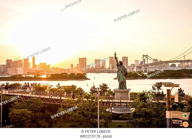 Tokyo skyline, Statue of liberty and Rainbow Bridge as viewed from Odaiba, Japan