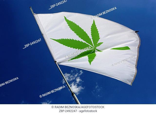 flag symbol, marijuana leaf, blue sky