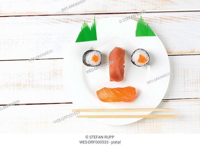 Sushi garnished on plate as a funny face