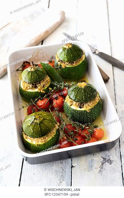 Zucchini filled with quinoa and cherry tomatoes