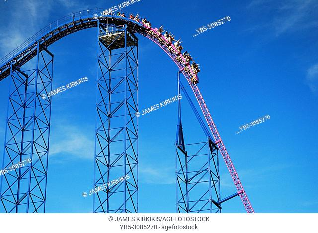 Thrill seekers head into a free fall descent on a roller coaster