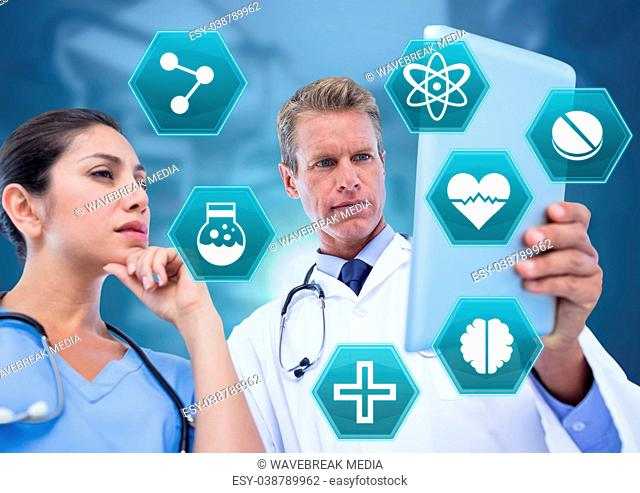 Doctor's holding tablet with medical interface hexagon icons