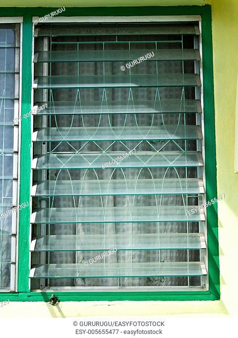 An opened glass louver window