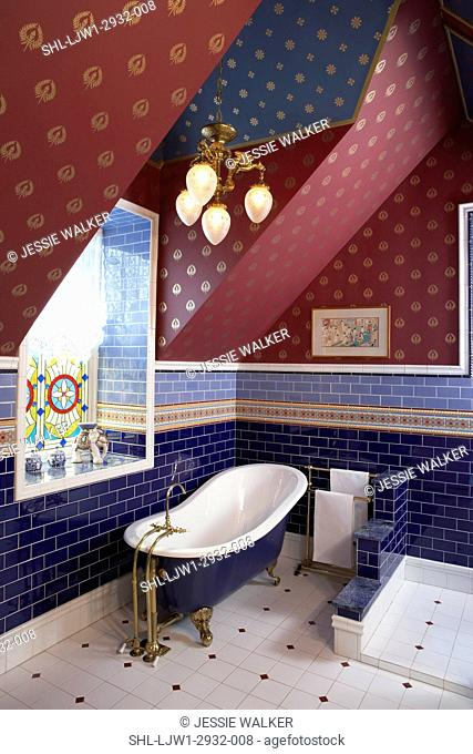 Bathrooms: Tile used as dado, shades of indigo and cornflower blue subway tile, painted indigo claw foot tub, antique Victorian light fixture