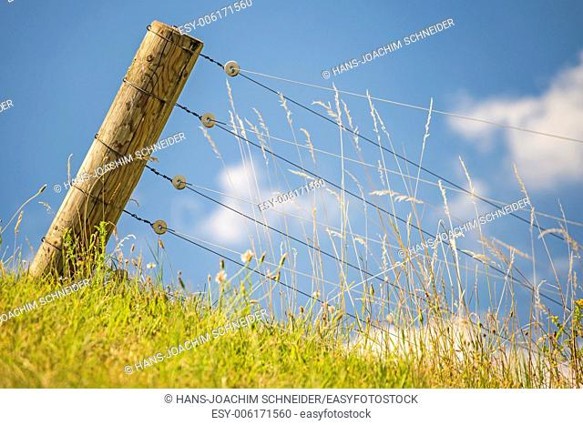 Fence with blue sky and clouds