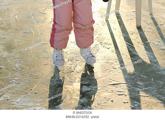 Caucasian girl skating on frozen ice
