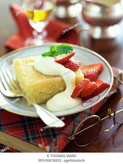 Piece of Scottish Lemon Cake with Strawberries and Cream