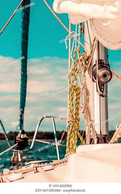 Yacht capstan with rope on sailing boat during cruise, marine objects concept