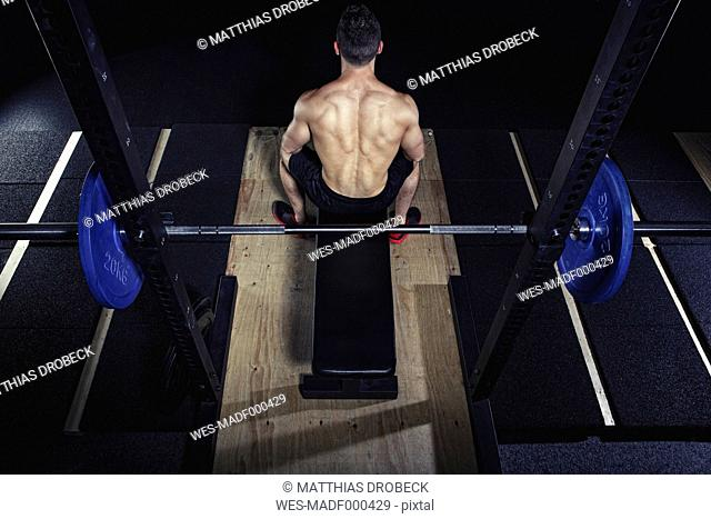 Physical athlete preparing for barbell bench presses
