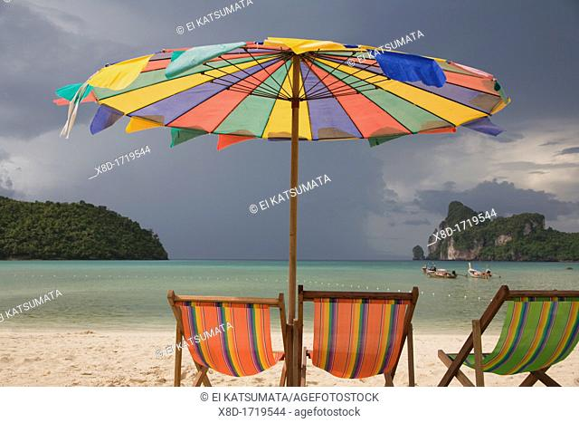 Beach chairs and umbrella at Ao Lo Dalam, Ko Phi Phi Island, Krabi Province, Thailand