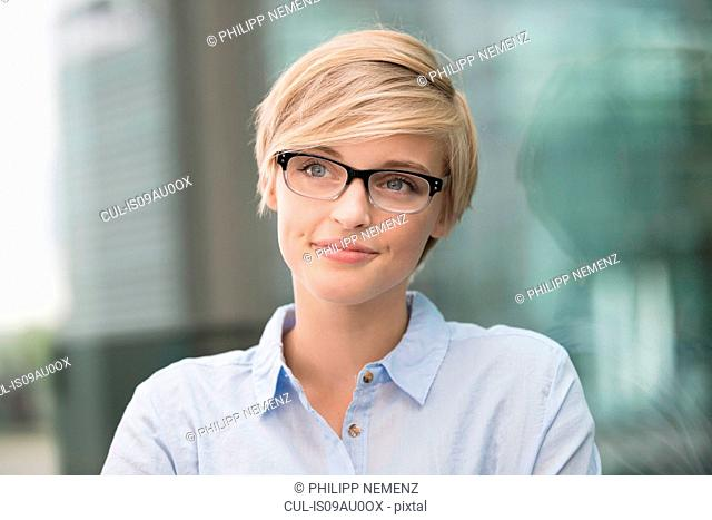 Young woman wearing stylish spectacles in city