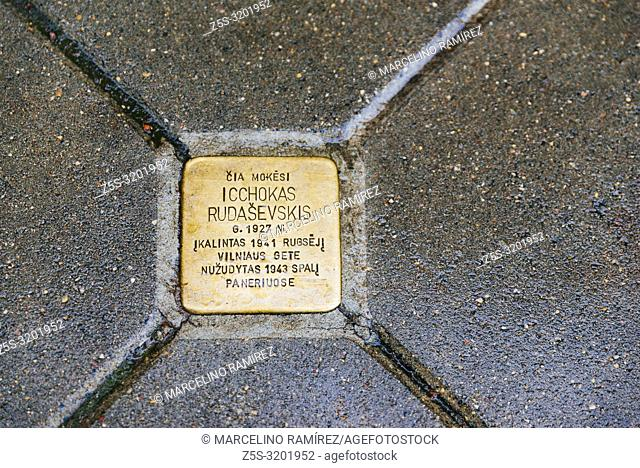 Copper-plated memorial plaque, embedded in the pavement of the old Town of Vilnius to commemorate the memory of residents of the city who fell victim to the...