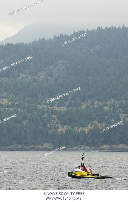 Tug Boat in the ocean with mountains in the background, Howe Sound, BC