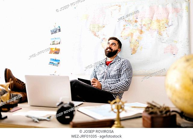 Young traveler planning his next trip from home