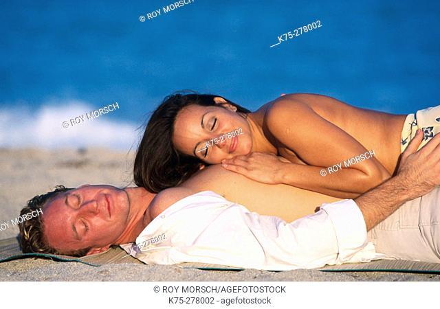 loving couple lying on the beach