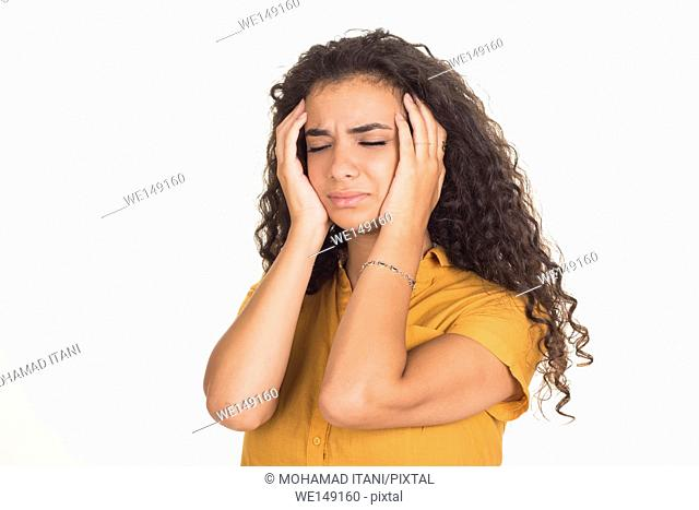 Young woman head in hands in pain