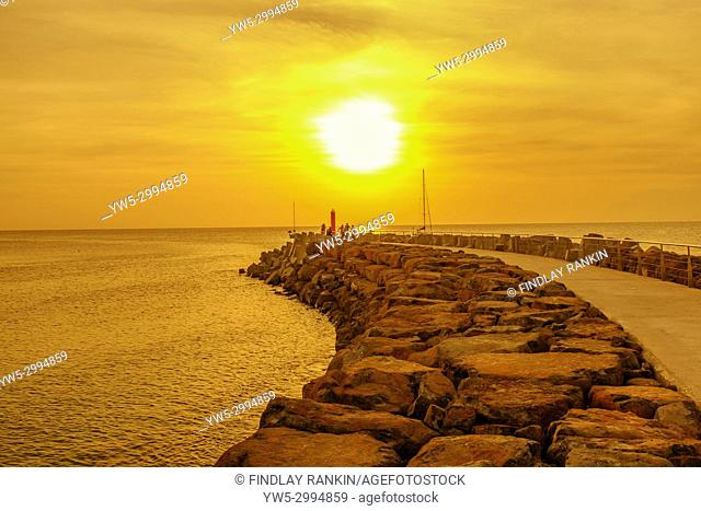 Sunset over the pier at Bikini Beach, Cape Verde, Africa