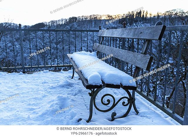 viewpoint over winterly forest with bench at dusk, Manderscheid, Rhineland-Palatinate, Germany